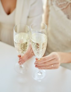 11299533-close-up-of-lesbian-couple-with-champagne-glasses